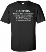 """GS2 - Gun Shirt 2 <p><strong><span style=""""font-size: 20px; font-family: Tahoma;"""">CAUTION<br /> Due to the increased<br /> cost of ammunition,<br /> Do NOT expect<br /> a warning shot</span></strong></p>"""